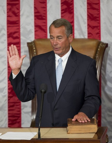 House Speaker John Boehner of Ohio takes the oath of office after being re-elected to a third term during the opening session of the 114th Congress, Tuesday, Jan. 6, 2015, on Capitol Hill in Washington.