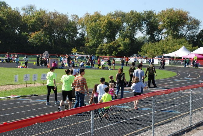 Walkers converged upon the Carrollton High School Stadium to raise money for Down syndrome last Saturday, Sept. 27, 2014.