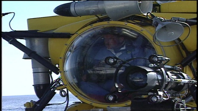 Larry Elliott filming inside a sub during a 1994 expedition to the site of the wreck of the Edmund Fitzgerald.
