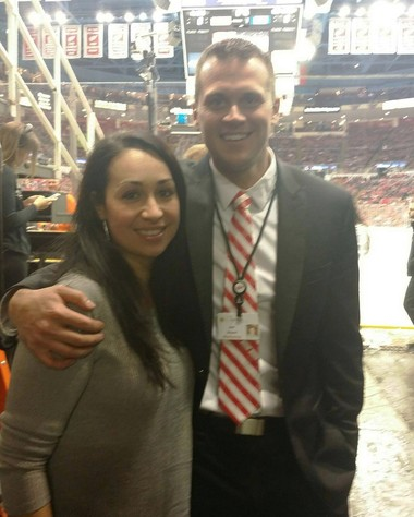 Honesty Elliot with Jim Bewier, event and experiential marketing manager for the Detroit Red Wings, at the game on Wednesday, April 6, 2016.