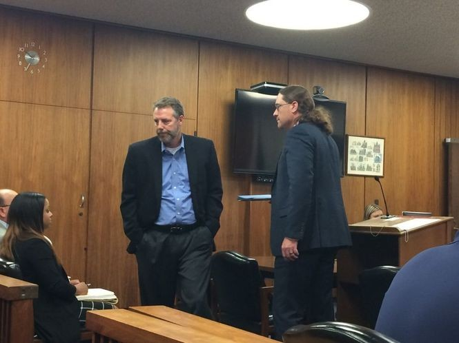 David Dennis, left, and attorney Jeffrey Rupp. Dennis was arraigned on Wednesday, June 21 at the Saginaw County Governmental Center.