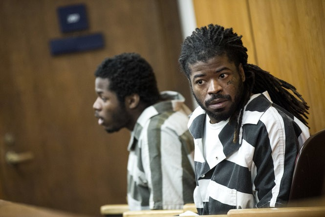 """Aaron S. """"Twin"""" Pinkston (left) and Jermonii D. Perry sit in a Saginaw courtroom."""