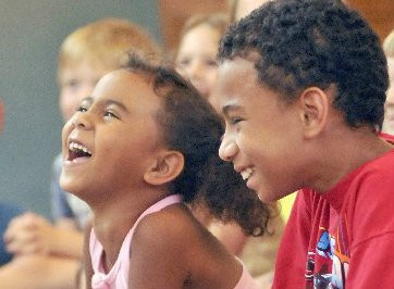 Amyra Terrasas, left, 5, and her brother Robert Terrasas, 9, children of Roxanne Terrasas of Saginaw laugh at juggler/comedian/magician Joel Tacey's show at Hoyt Library, 505 Janes in Saginaw (7/13/09). The show was part of the Public Libraties of Saginaw 2009 Summer Reading Program.