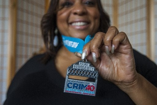 Samona Perry of Saginaw poses for a portrait with the medal she won by competing in the Crim Festival of Races at Kingdom Life Ministries, 310 S. Jefferson in Saginaw on Tuesday, Aug. 30, 2016.