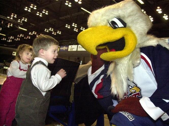 Will and Chloe Vondette, 2-year-old twins from Freeland, visit Sammy Spirit during a Saginaw Spirit game in 2004.