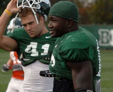 Michigan State linebacker Chris Norman (right) will pursue seminary rather than a professional football career.