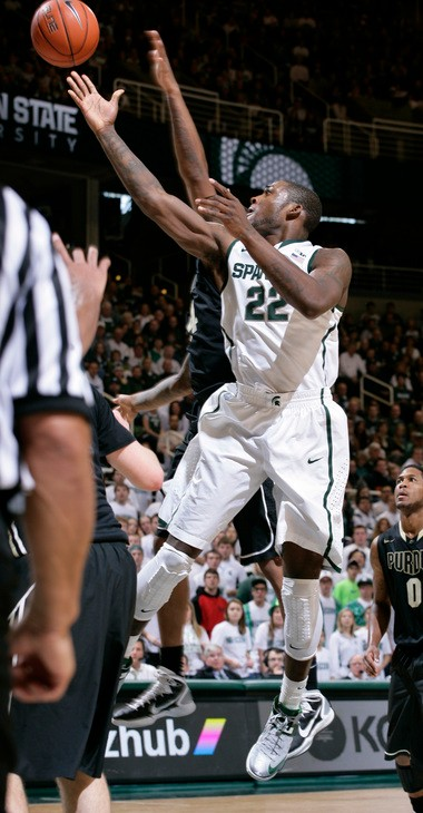 Michigan State's Branden Dawson (22) puts up a lay-up and draws a foul from Purdue's Jacob Lawson, rear, during the second half of an NCAA college basketball game, Saturday, Jan. 5, 2013, in East Lansing, Mich. Michigan State won 84-61.