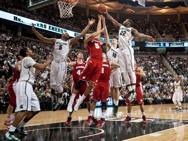Michigan State and Wisconsin basketball players jump for a rebound after a Keith Appling 3-point miss during their game at the Breslin Center in East Lansing on Thursday, March 7.