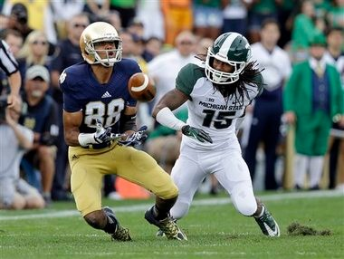 It was a rough day for Michigan State cornerback Trae Waynes, shown here getting beat by Notre Dame's Corey Robinson.