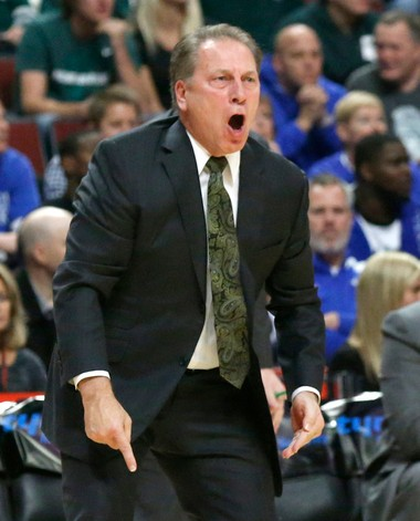 Michigan State coach Tom Izzo yells at his team during the first half of an NCAA college basketball game against Kentucky on Tuesday, Nov. 12, 2013, in Chicago.