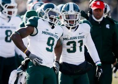 Michigan State senior safety Isaiah Lewis, left, talks with cornerback Darqueze Dennard as the players awaited the officials' ruling of a targeting call in the first quarter. Lewis was ejected after the play was reviewed, much to the chagrin of coach Mark Dantonio in the Spartans' 30-6 win at Northwestern on Saturday.