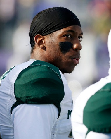 Michigan State cornerback Darqueze Dennard (31) on the sideline before an NCAA football game against Northwestern on Saturday, Nov. 23, 2013, in Evanston, Ill.