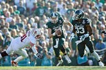 Michigan State QB Connor Cook threw a Pick-6 and Stanford dropped two other potential interceptions, but Cook overcame his tough moments and made several other strong throws after extending plays with his scrambling abilities en route to a Rose Bowl Offensive Player of the Game performance with a career-high 332 yards passing in a 24-20 win over the Cardinal. (Mike Mulholland | MLive.com)