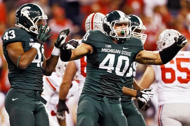 Michigan State middle linebacker Max Bullough, a third-team All-American selection this season, celebrates a sack in the Spartans' 34-24 victory over Ohio State in the Big Ten title game.