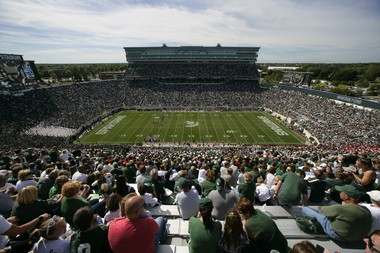 Spartan Stadium as it looked in 2013, showing the 2005 press box and luxury suites addition as well as 2012's video board upgrade on both the south and north ends of the stadium.