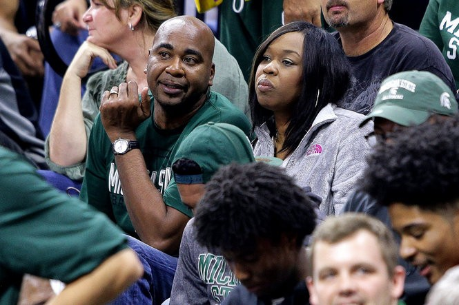Jeff and Stephanie Ward, parents of Michigan State forward Nick Ward, talk during a timeout of an exhibition at Breslin Center on Nov. 2.