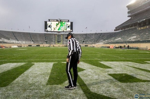 A Big Ten official inspects the turf at Spartan Stadium as Penn State and Michigan State are in a delay due to a weather emergency on Nov. 4, 2017. The stoppage took place in the second quarter. Joe Hermitt | jhermitt@pennlive.com