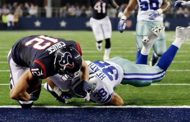 Dallas Cowboys defensive back Jeff Heath tries to bring down Houston Texans wide receiver Andy Cruse in the final preseason for both teams.