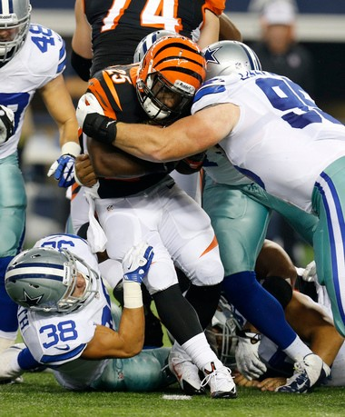 Dallas Cowboys defensive back Jeff Heath (38) and nose tackle Sean Lissemore (95) combine to stop Cincinnati Bengals running back Giovani Bernard (25) on a run during the second half of a preseason NFL football game.