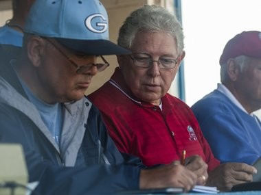 Ritchie Clayton, right, looks over at Gary Stefaniak's records in the press box during the 2016 Pony League North Zone championship game.