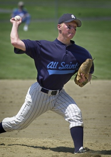 All Saints pitcher Andy Regulski delivers a pitch in the 2000 regional semifinal. Regulski went 5-0 in the postseason to lead the Cougars to the state title. (Dick VanNostrand | MLive file)
