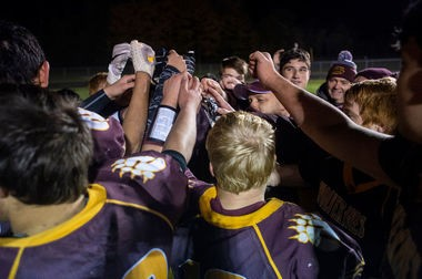 The Au Gres football team huddles together during its playoff win over Mayville this season. (Kaytie Boomer | MLive.com)