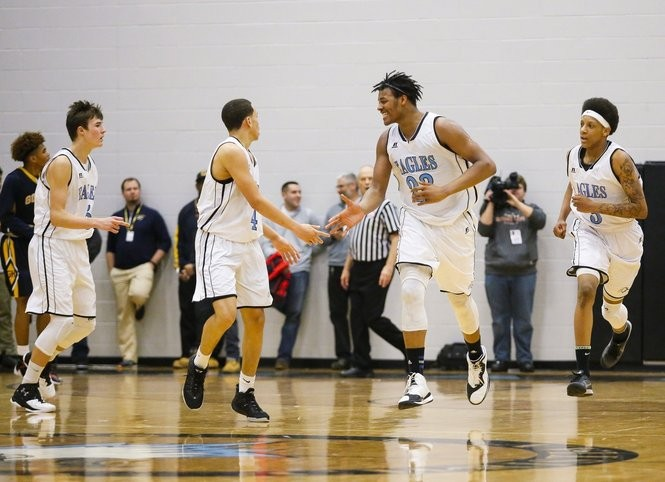 Washington (4) and Tillman (23) high-five during a March 1, 2016, game at Grand Rapids Christian.