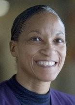 Linnell Jones McKenney poses for a portrait on at Flint Northwestern High School in Flint, Mich.