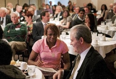 Judge Duncan Beagle (right) talks with Olympic Gold Medalist Claressa Shields about her boxing career as the guest speaker during a Rotary Club meeting at the Sarvis Center in Flint.