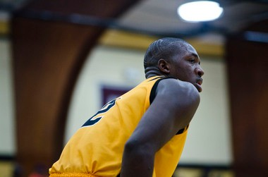 Mott Community College freshman Coreontae DeBerry stares at his coach on the sidelines during MCC's men's basketball game against Schoolcraft College on Saturday, January 26, 2013.
