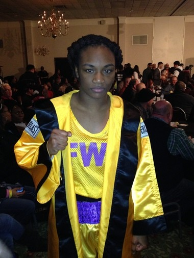 Flint boxer Claressa Shields defeated three-time world champion Mary Spencer on Saturday, Feb. 16 in Lansing at the Ramada Lansing Hotel and Conference Center.