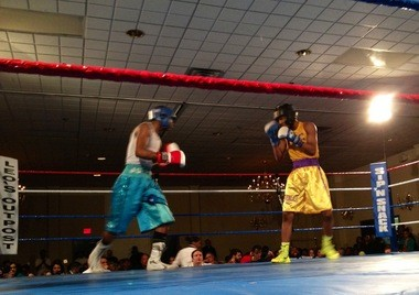 Flint boxer Ardreal Holmes (right) defeated Jordon Jackson of Illinois on Saturday, Feb. 16 in Lansing. The referee stopped the contest in the third round.