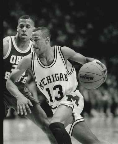 Flint native Demetrius Calip (No. 13) drives past an Ohio State player during a game in the early 1990s.