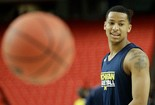 Michigan's Trey Burke watches play during practice of the NCAA Final Four tournament in Atlanta.