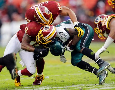 Philadelphia Eagles running back LeSean McCoy collides with Washington Redskins free safety Madieu Williams (41) and linebacker Lorenzo Alexander during the second half of an NFL football game in Landover, Md., Sunday, Nov. 18, 2012. The Redskins won 31-6. McCoy was injured on the play.