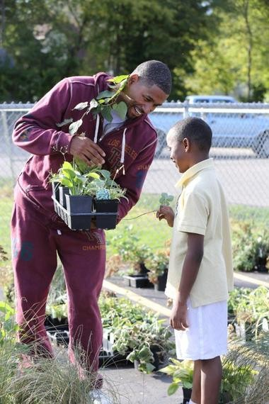 Flintstone basketball star Charlie Bell interacts with a member of the Boys & Girls Club of Greater Flint on Wednesday, Sept. 25, 2013.