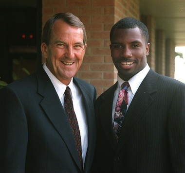 Lloyd Carr and Andre Weathers strike a pose during the U of M dinner at the Atlas Valley Country Club Tuesday, July 13, 1999.