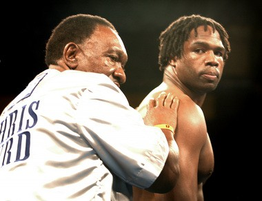 Surrounded by family in his corner, Chris Byrd and his father Joe Byrd Sr. enter the ring for the start of his bout with Fres Oquendo as Byrd defended his IBF heavyweight Championship Saturday September 20, 2003, at Mohegan Sun in Uncasville, CT. Byrd successfully defended his title. (Date shot: 9/20/03) ( / STEVE JESSMORE)