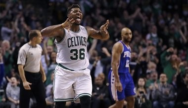 Boston Celtics guard Marcus Smart (36) celebrates after hitting a 3-pointer during the second half of an NBA basketball game against the Philadelphia 76ers in Boston, Wednesday, Feb. 15, 2017. The Celtics defeated the 76ers 116-108. (AP Photo/Charles Krupa)