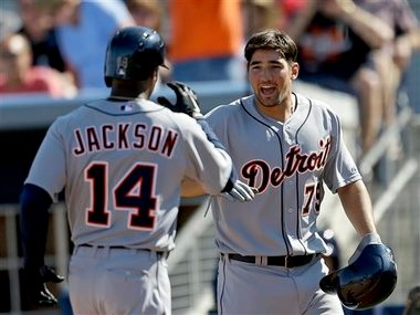 Detroit Tigers' Austin Jackson, left, is greeted by teammate Nick Castellanos, after hitting a two-run home run in the sixth inning of a spring training game against the Tampa Bay Rays.