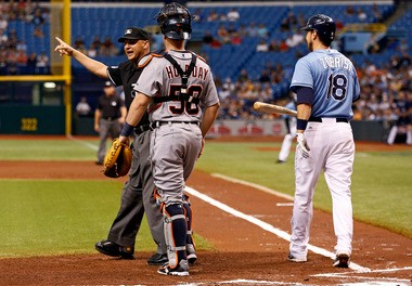 Home-plate umpire Vic Carapazza warns both benches Sunday afternoon after Detroit Tigers right-hander hit Tampa Bay Rays second baseman Ben Zobrist with a pitch in the first inning.