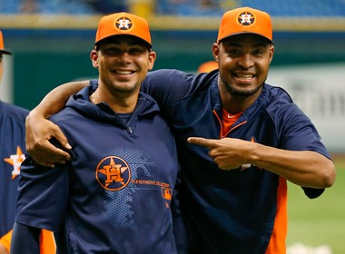 Jose Veras, right, shown joking with Houston Astros teammate Carlos Pena, should help shore up the bullpen in 2014 as well. His current contract has a club option for the 2014 season.