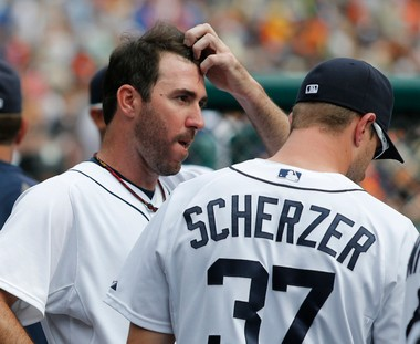 Justin Verlander talks with Max Scherzer on Thursday after pitching the seventh inning against the Minnesota Twins.