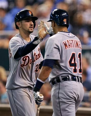 Detroit Tigers' Nick Castellanos (30) is congratulated by Victor Martinez (41) after scoring on a bases loaded walk to Miguel Cabrera in the fifth inning against the Kansas City Royals on Saturday.