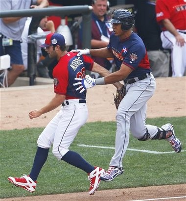 United States' pitcher Daniel Norris, left, forces out World's Steven Moya, right, at first base during the second inning of the All-Star Futures on Sunday in Minneapolis.