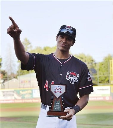 Detroit Tigers outfield prospect Steven Moya acknowledges fans after receiving the Eastern League Most Valuable Player award before the SeaWolves played the Bowie Baysox in a game at Jerry Uht Park in Erie, Pa. on Aug. 28.