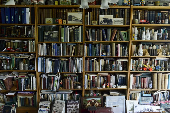 "John Kilcherman and his wife Phyllis are not just collectors of rare apples trees, but also of books, magazines, art, and figurines. ""It's like a museum instead of a house,"" said Phyllis of all the vast amounts of collections the couple has curated over the years. (Emily Rose Bennett 
