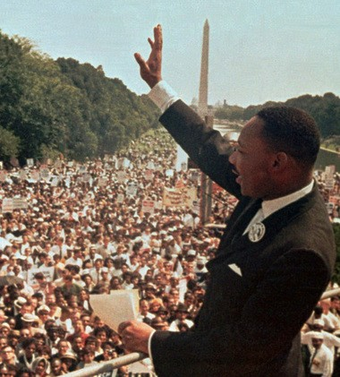 "Dr. Martin Luther King Jr. acknowledges the crowd at the Lincoln Memorial for his ""I Have a Dream"" speech during the March on Washington, D.C. in this Aug. 28, 1963 photo. (AP File Photo)"