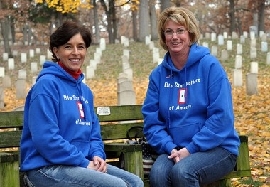 Diane Schwaiger, left, and Jan Vander Wal are among the Ottawa-North Kent Blue Star Mothers who hope to be able to raise enough money to place a wreath on each of the 5,200 graves in the Grand Rapids Veterans Cemetery.
