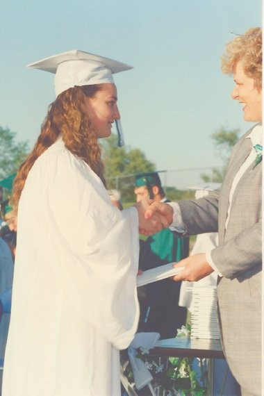 This photograph shows Mars One candidate Laura Smith-Velazquez at her graduation from Wayland Union High School in 1994. A school official has identified the woman giving out the diplomas as former school board member Diane Butler.